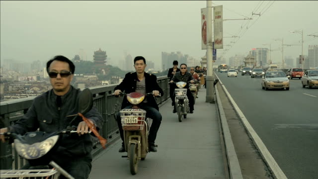 Traffic with motorbikes going on pedestrian area in China