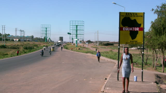 Traffic With Woman Walking From Equator Sign Nanyuki  Kenya