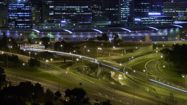 T/L MS PAN TU Traffic zipping along Kwinana Freeway in night / Perth, Western Australia, Australia