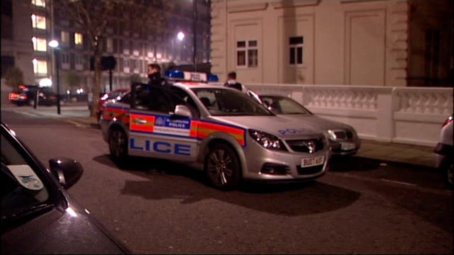 police crack down on suspected prostitution ring; england: london: paddington: ext/early morning plain clothes police at doorway of housing block... - trafficking stock videos & royalty-free footage