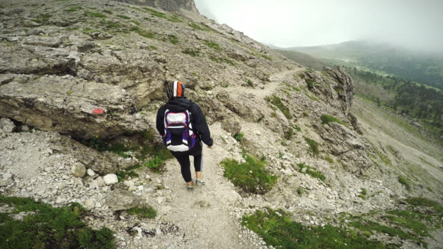 trail hiking on the mountain with friend pov - val di fassa stock videos and b-roll footage