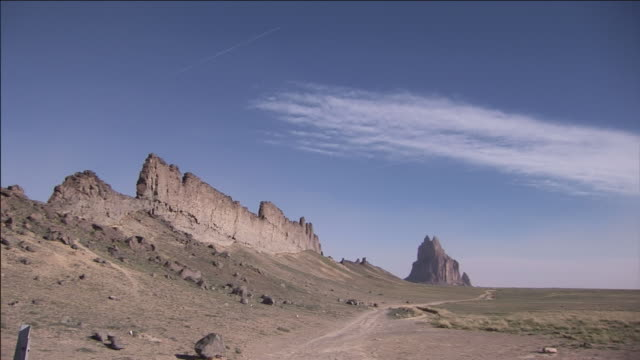 a trail leads to shiprock on the navajo nation. - navajo culture stock videos & royalty-free footage