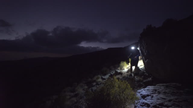 trail runner descending trail at night with headlamps - cross country running stock videos & royalty-free footage