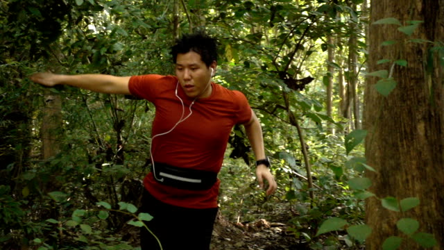 SLO MO Trail Runner Running in Forest