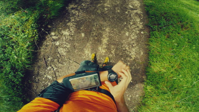 POV Trail running in the forest: checking smart watch