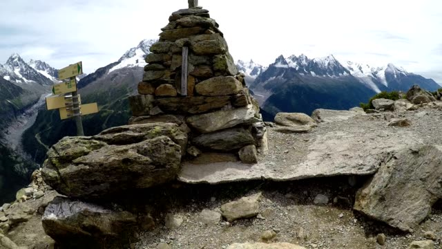 trail signpost and rock cairn hiking in the french alps near chamonix - auvergne rhône alpes stock videos & royalty-free footage