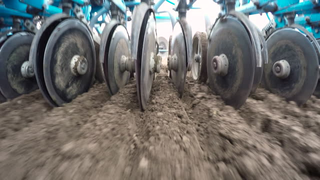trailer harrows soil in field, uk - agricultural machinery stock videos & royalty-free footage