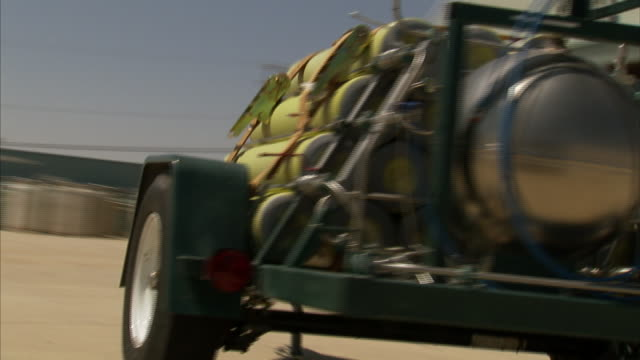 a trailer holds a stack of helium tanks and equipment. - helium stock videos & royalty-free footage