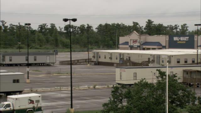 stockvideo's en b-roll-footage met trailer houses fill a walmart parking lot in new orleans. - wal mart