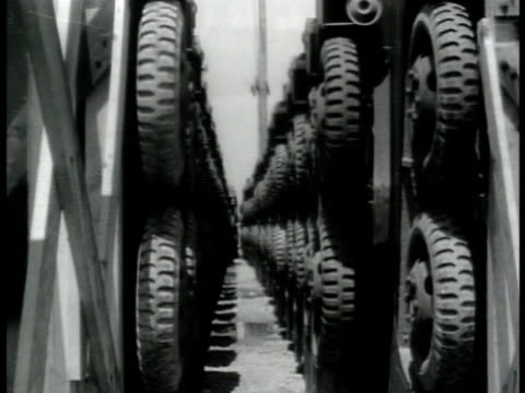 vídeos de stock, filmes e b-roll de trailers standing up in row hitches pointing up ls row between stacked trailers rows of parked ambulance trucks rows of covered trucks halfton - 1943
