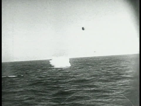 trails of smoke toward aircraft xws unidentified aircraft crashing nose first into water british bomber in flight bombs landing near ship pompoms... - battleship stock videos & royalty-free footage