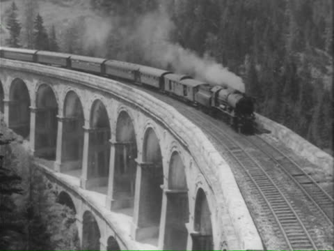vidéos et rushes de ms pan train across bridge / various including barmouth, gwynedd, wales - 1950 1959