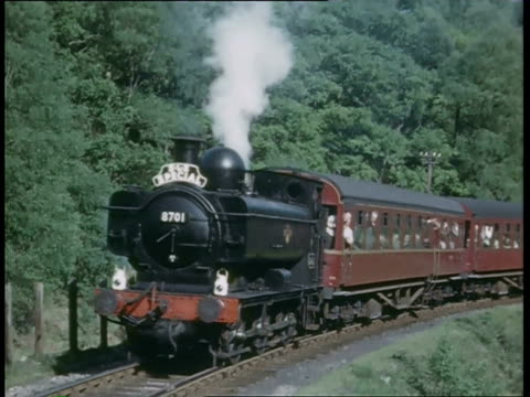 stockvideo's en b-roll-footage met ms train across countryside with maintennce on train and steam engines moving slowly at station/sheds / derbyshire, england - derbyshire