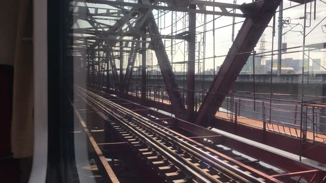 train across metal bridge at chao praya river, thailand - elevated train stock videos & royalty-free footage