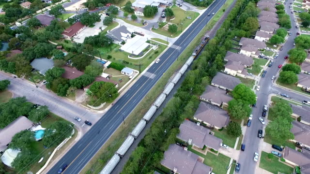 train aerial above homes and houses in suburb new modern development in central texas outside of austin, tx - modern rock stock videos & royalty-free footage