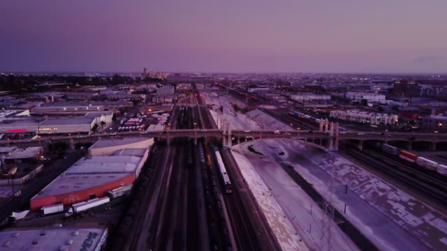 train alongside los angeles river after sunset - aerial shot - union station los angeles stock videos & royalty-free footage
