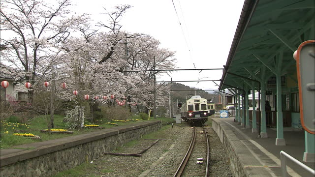 a train approaches bessho onsen station in japan. - nagano prefecture stock videos and b-roll footage
