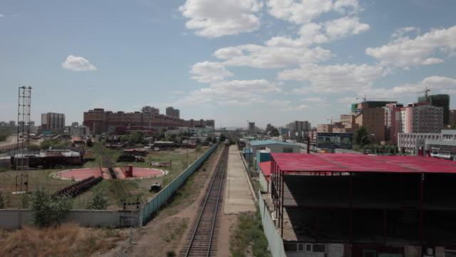train approaching a bridge in ulan bator, mongolia - ulan bator stock videos & royalty-free footage
