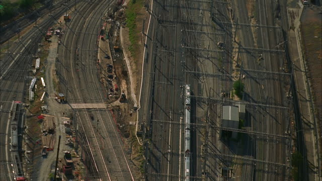 aerial train approaching atocha railway station, madrid, spain - railroad station stock videos & royalty-free footage