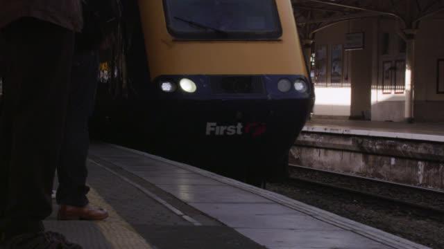 Train arrives at platform in Temple Meads train station, Bristol, England