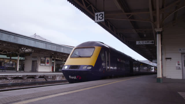 train arrives at platform in temple meads train station, bristol, england - rail transportation stock videos & royalty-free footage