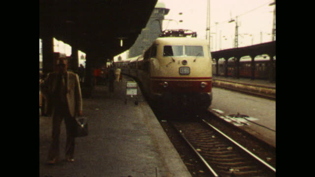 vidéos et rushes de train arrives at train station in frankfurt / main, shots through the window while driving when other train passes, views to the railroad, goods... - temps réel