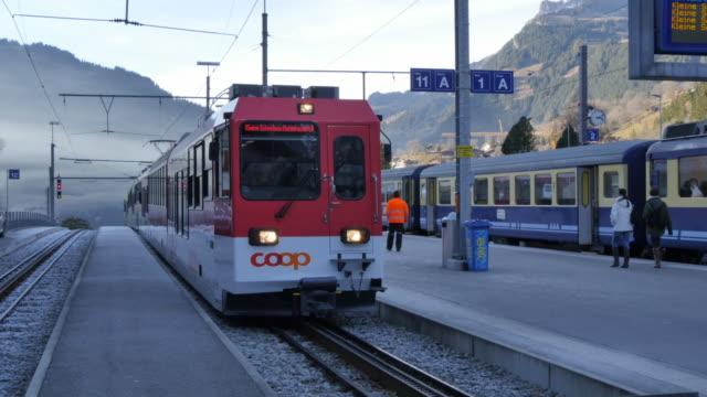 Train arriving from Kleine Scheidegg at Grindelwald Station, Bernese Oberland, Canton of Bern, Switzerland, Europe