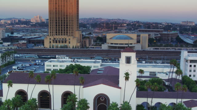 train arriving in union station, los angeles - drone shot - union station los angeles stock videos & royalty-free footage