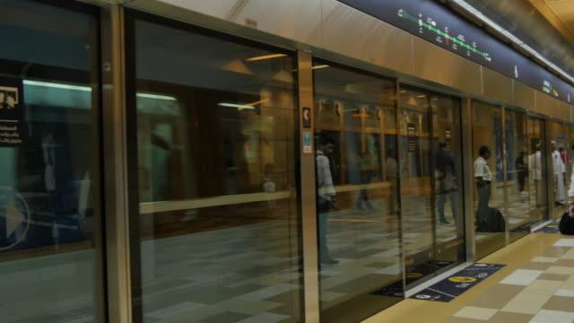Train arriving Metro Station on Underground section, Dubai, United Arab Emirates, Middle East, Asia