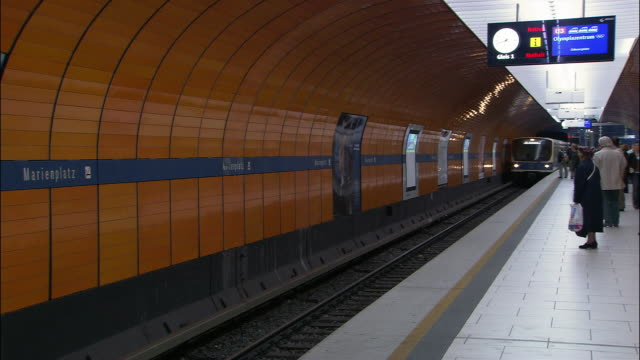 MS train arriving on Marienplatz underground station, passengers exiting and entering train, Munich, Bavaria, Germany