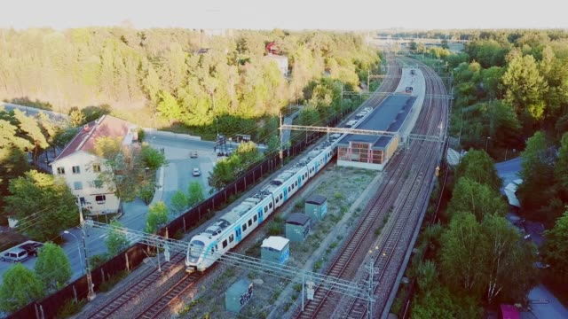 train arriving to trainstation helenelund, sollentuna, stockholm - sweden stock videos & royalty-free footage