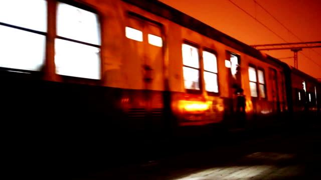 train at night on railroad station - treno pendolare video stock e b–roll