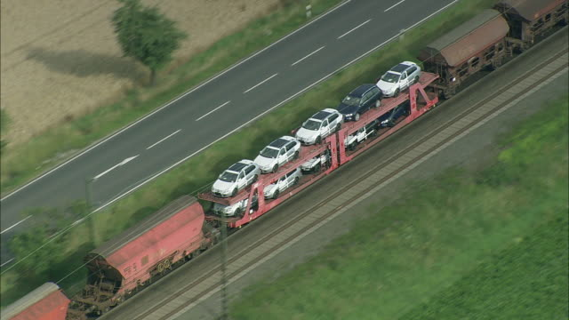 aerial zo train carrying cars, thuringia, germany - turingia video stock e b–roll