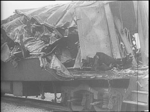 train cars are derailed / four soldiers killed as crack passenger train and troop carrier meet head on / windows are broken in a train car / the roof... - bahnreisender stock-videos und b-roll-filmmaterial