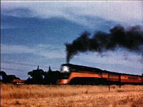 1950 train chugging thru countryside / industrial - londonalight stock videos and b-roll footage