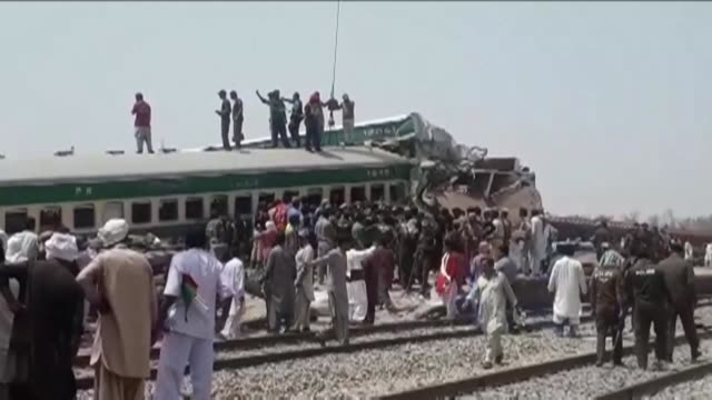 a train collision in pakistan claims several lives and injures dozens - train crash stock videos and b-roll footage