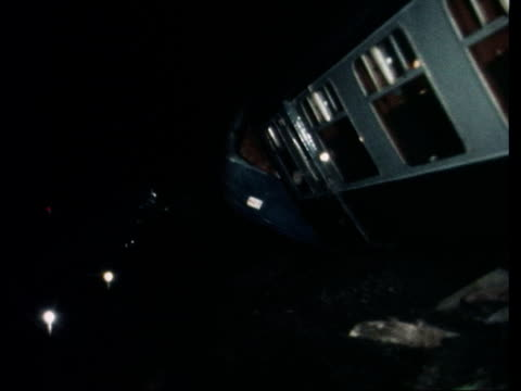 herts watford l scenes of crash both trains airv one coach airv ditto night ms one coach ms people towards from crash bv into car ms drivers cab down... - train crash stock videos and b-roll footage