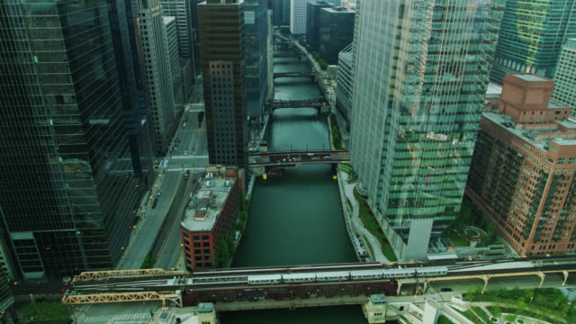 l train crosses chicago river over wells st bridge - aerial - chicago 'l' stock videos & royalty-free footage