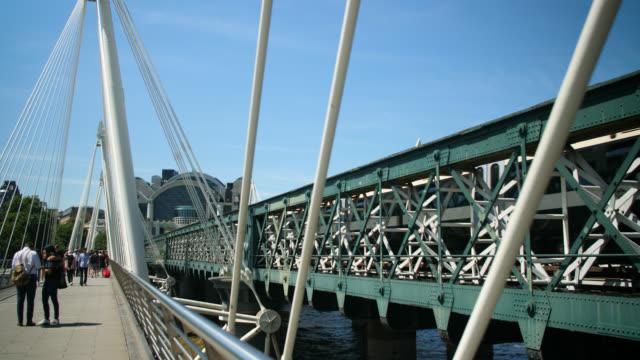 train crosses hungerford bridge in london - hungerford bridge stock videos & royalty-free footage