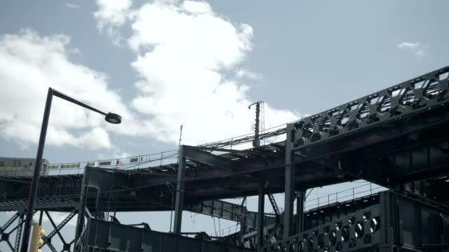 ms train crosses overhead platform with street lamp - högbana bildbanksvideor och videomaterial från bakom kulisserna
