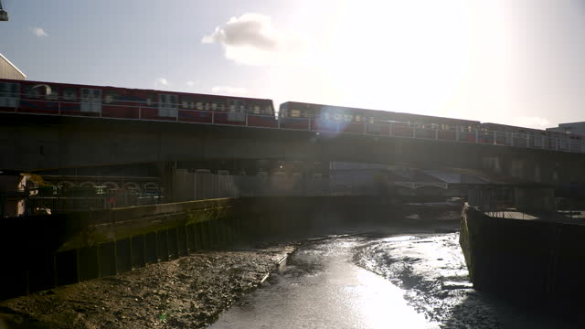 train crosses railway bridge over river, london - small group of animals stock videos & royalty-free footage