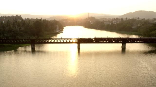 train crossing a bridge at sunset: sri lanka - arch bridge stock videos & royalty-free footage