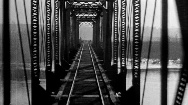 train crossing bridge over river train pov over train trestle tracks 1916 - anno 1916 video stock e b–roll