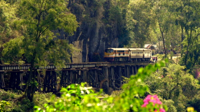 train crossing krasae viaduct in kanchanaburi, thailand - thailand stock videos and b-roll footage