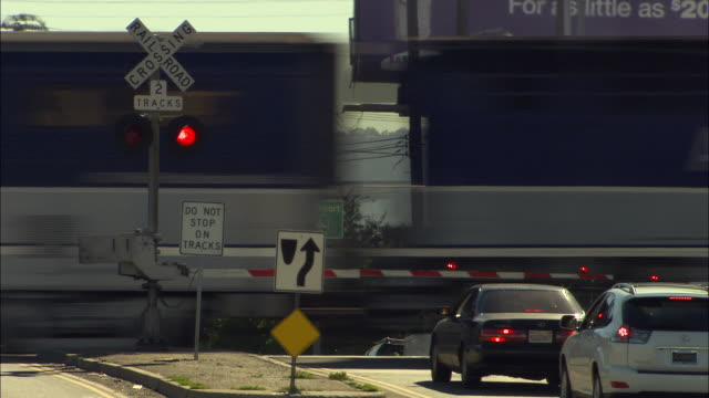 ms, train crossing lankershim boulevard, north hollywood, los angeles, california, usa - level crossing stock videos & royalty-free footage