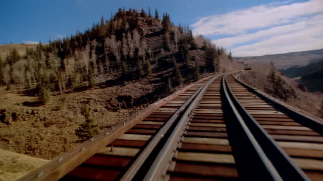 POV train crossing railway bridge Rocky Mountains, Colorado, USA