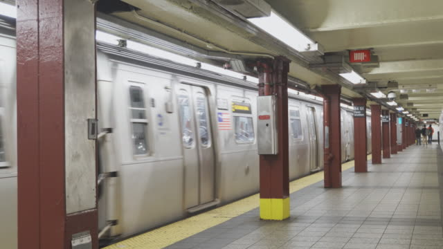 a train departed from 34th street - penn station train station in new york city deserted because of covid-19 coronavirus outbreak. - new york city penn station stock videos & royalty-free footage