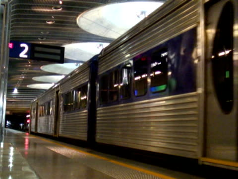 train departs colorful underground station - tramway stock videos & royalty-free footage