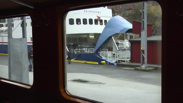 stockvideo's en b-roll-footage met train departs from flåm railway station - kees van den burg