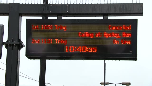 Train disruptions caused by storms and lightning Kings Langley Train along through station Departure board showing cancellation of Tring service...